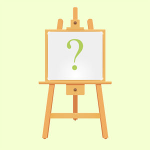 easel with green background and green question mark